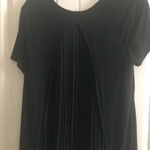 Express open back with sheer accordion pleats top